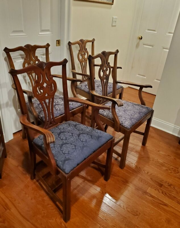 Four Chippendale Arm Chairs