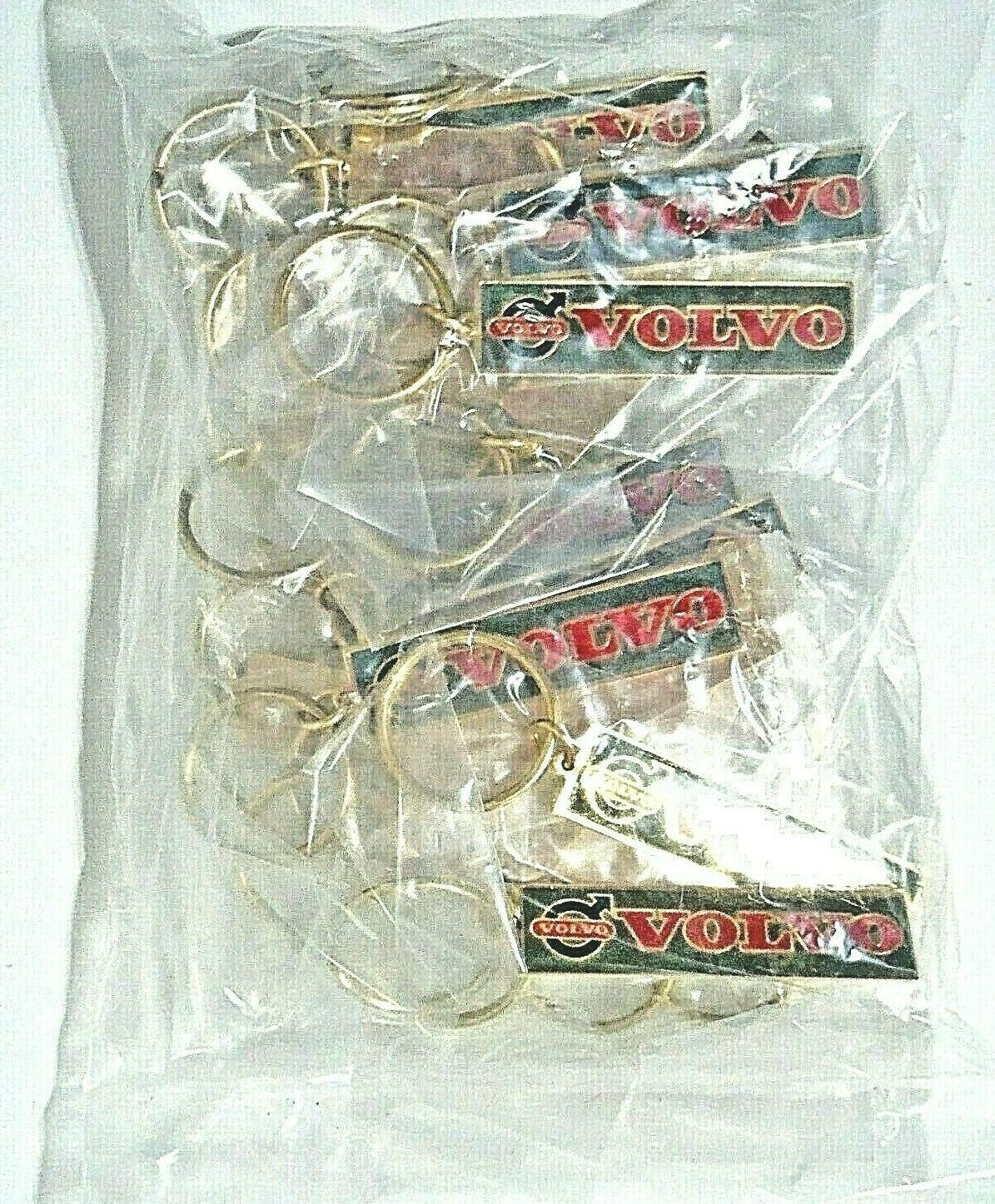 25 INDIVIDUALLY WRAPPED Vintage VOLVO Brass Keychains Deadstock NOS