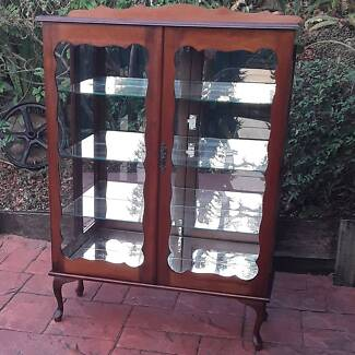 Antique style solid Mahogany china display cabinet.