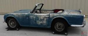 INTERESTED IN YOUR OLD BRITISH SPORTS CAR PROJECT + BIKES
