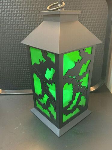 """Halloween led lantern. creepy flickering ..green. 12"""" tall. new. batt pattern."""