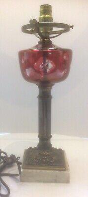 Antique cranberry sandwich glass and brass oil lamp on marble, electric conv.