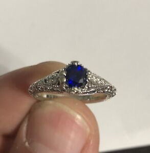 10 karat white gold right with 5mm Chatham Blue Sapphire