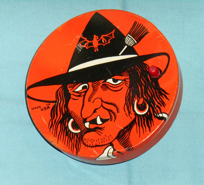 vintage HALLOWEEN NOISEMAKER round witch with jagged teeth and whiskers