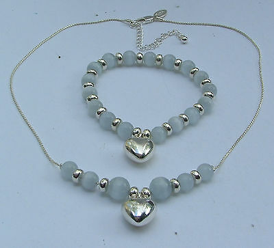 SILVER PLATED HEART PENDANT AND BRACELET SET WHITE CATS EYE GLASS