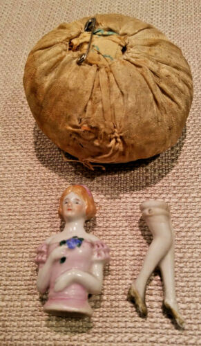ANTIQUE PORCELAIN LADY WITH LEGS PIN CUSHION