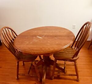MOVING SALE: Oak Table and Chairs (including extra chair & leaf)