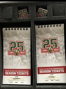 Centre Ice Mooseheads tickets behind players bench.