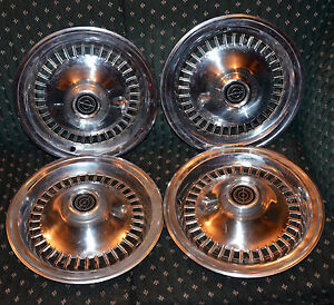 Matching set of four Ford Thunderbird hubcaps