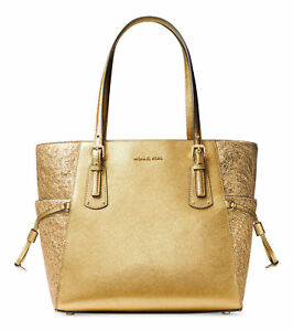f6991a1174e7db Michael Kors Voyager East West Signature Tote Handbag Gold 100 Authentic