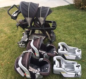 Twin stroller and car seats with bases
