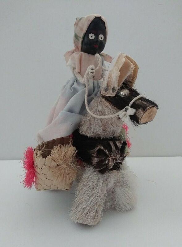 Vintage Black Americana Doll Riding a Stubborn Donkey