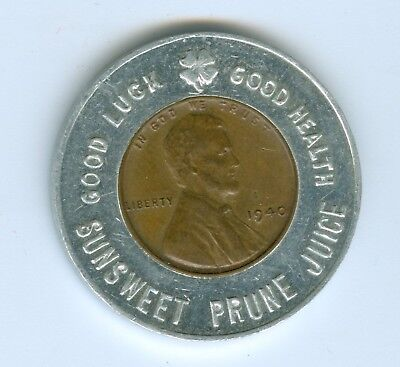 ENCASED BY SUNSWEET PRUNE JUICE A 1940 LINCOLN CENT