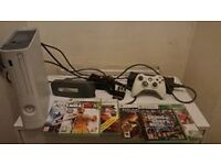 Xbox 360 with 6 games and 2 joystick