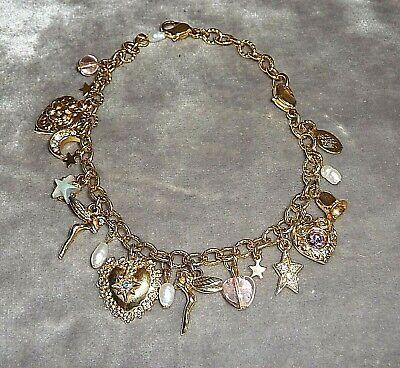 Vintage Kirks Folly Dreamkeeper charm bracelet. Wedding bells, fairies, love