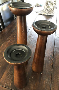 3 wooden candle stands