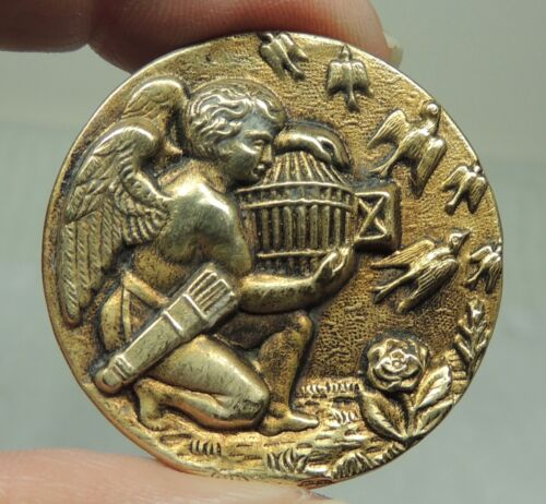 """ANTIQUE BRASS PICTURE BUTTON ~ CHERUB RELEASING BIRDS FROM A CAGE  1 5/16"""""""