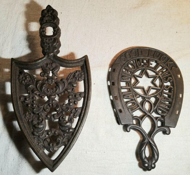2 ANTIQUE CAST IRON TRIVETS-GOOD LUCK TO ALL WHO USE THIS STAND HORSESHOE &ARROW