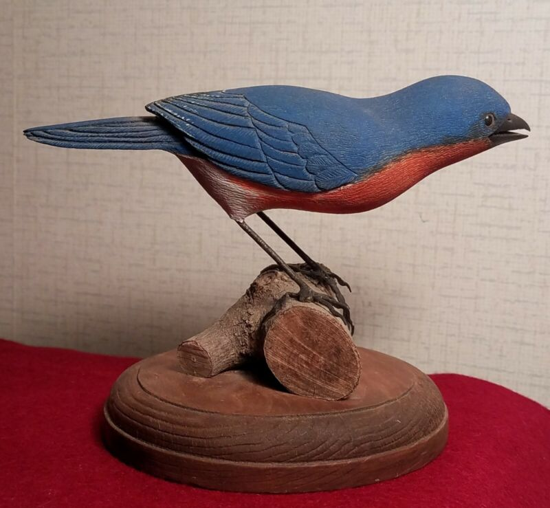 Carved wooden bluebird with open beak, by W. B. Gunstone of Columbus, NC