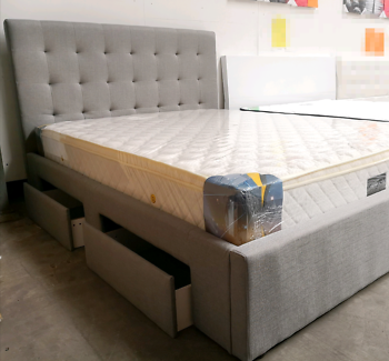 Brand new fabric bed with drawer.