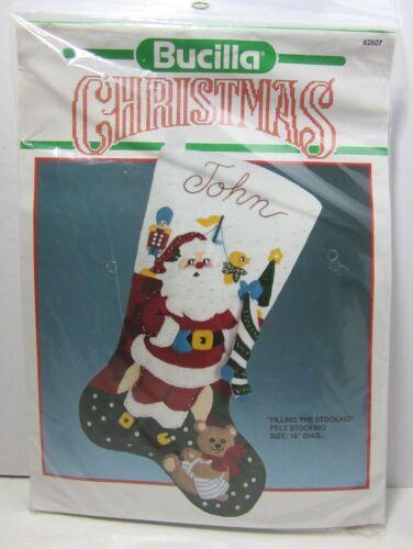 "Bucilla Christmas Santa Filling The Stocking Felt Applique Stocking 18"" Kit82607"