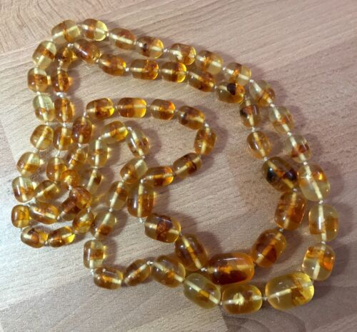 Vintage early plastic faux amber knotted necklace