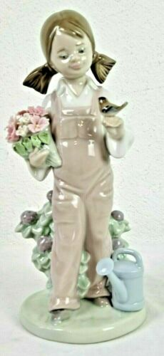 """Retired LLADRO #5217 """"Spring"""" girl with flowers, Bird and watering can MIB w/Box"""
