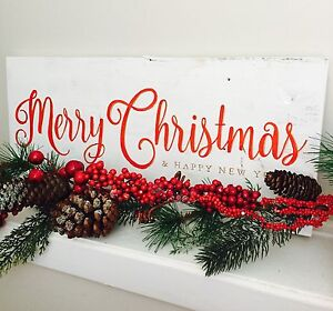 Merry Christmas sign hand painted on reclaimed shiplap