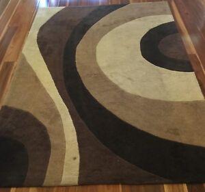 Two acrylic rugs