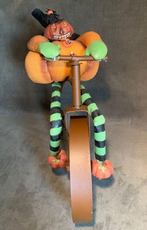 Folk Art Primitive Halloween Pumpkin Riding A Bike