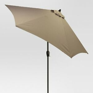 Taupe patio umbrella with heavy duty precast concrete base