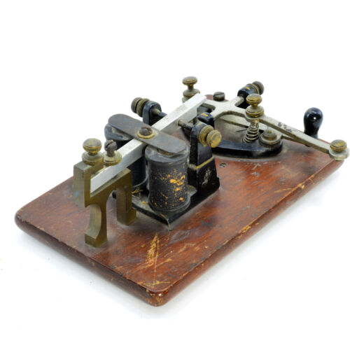 Telegraph key and sounder mounted on a wooden base.