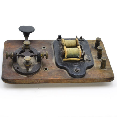 Older Telegraph key and sounder mounted on a wooden base