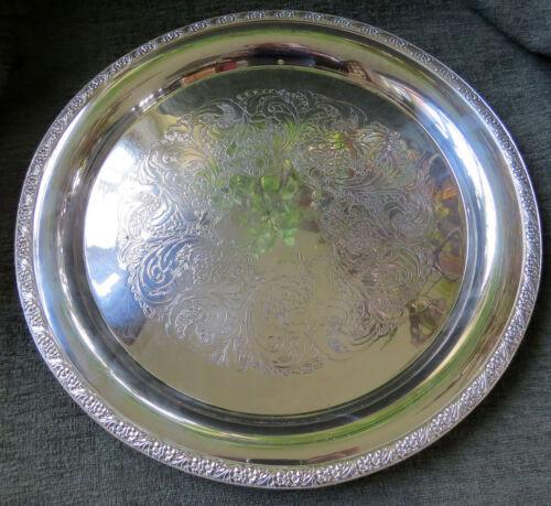 Vintage heavy silver serving tray 14.25 inch diameter