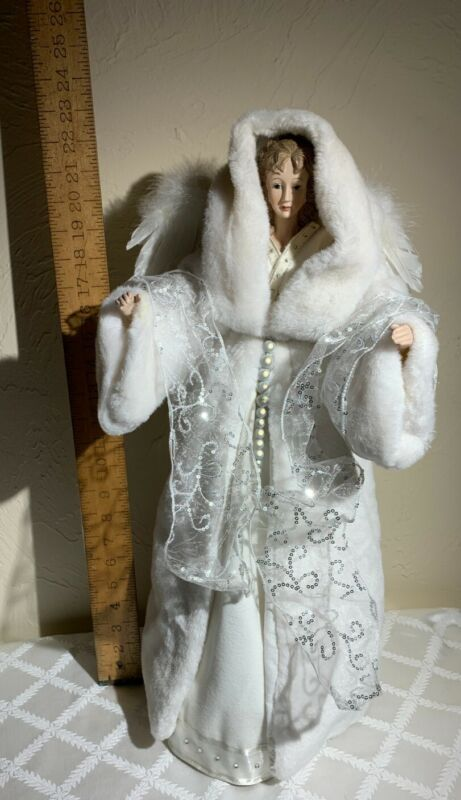 Angel tree topper. Wearing white gown & white fur(faux)coat with hood