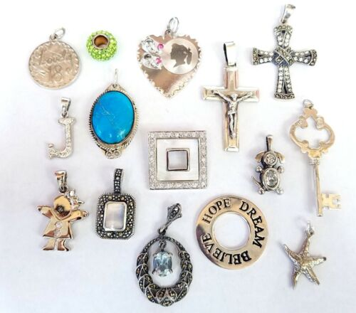 WHOLESALE LOT OF 15 VARIOUS STYLES AND SIZES OF STERLING SILVER CHARMS 45 GRAMS