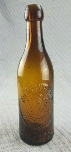 Undug Antique Amber Wm Reinhardt Newark NJ Blob Top Beer Bottle with logo