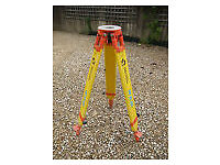 Yellow engineering surveyor tripod