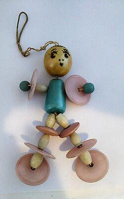 Vintage Crib Toy Wood Bead Celluloid Disc Little Girl Figure on Elastic Cord