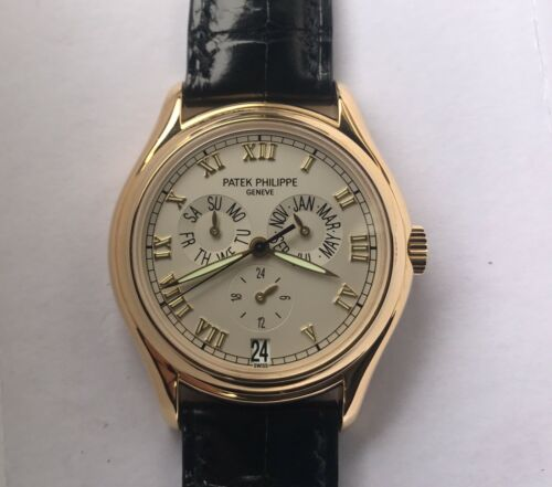 $19950.00 - NOS Patek Philippe 5035J Annual Calendar -White Ceramic Dial-18k Gold-Box/Papers
