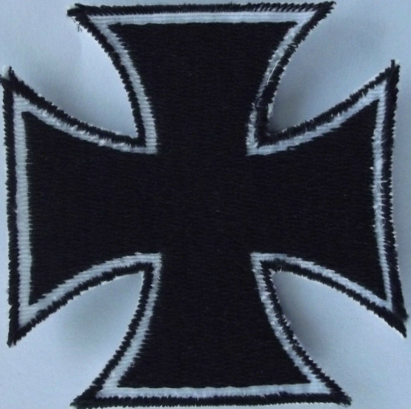 Maltese cross embroidered cloth patch.      A031002