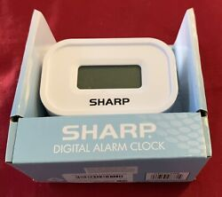 Sharp LCD Display Digital Alarm Clock Ascending Alarm Battery Operated Small