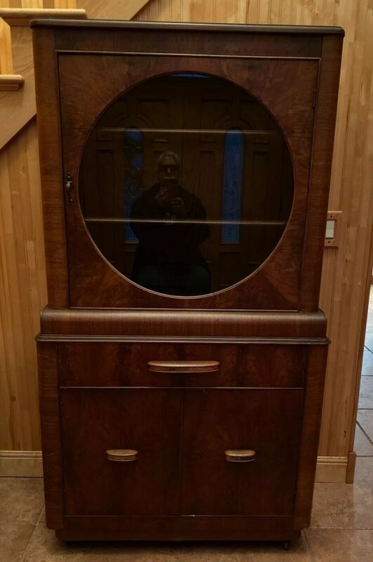 VINTAGE CABINET CURIO BUFFET CIRCLE GLASS, SHELVES, DRAW AND CABINET ON WHEELS