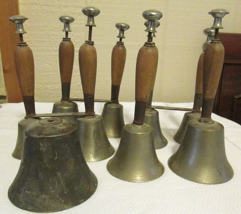 Vintage Set of 9 Brass or Bronze Wooden Handle Musical Instrument Bells