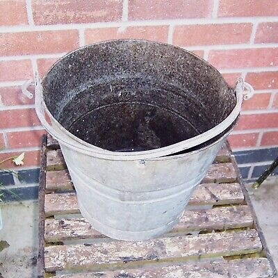 Vintage galvanized bucket watertight use planter display feature film prop