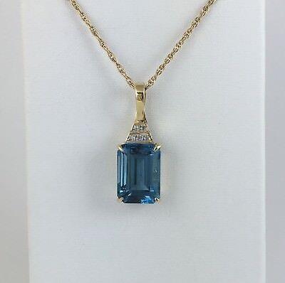 - 8.75 ctw Emerald Cut London Blue Topaz & Diamond Enhancer Pendant