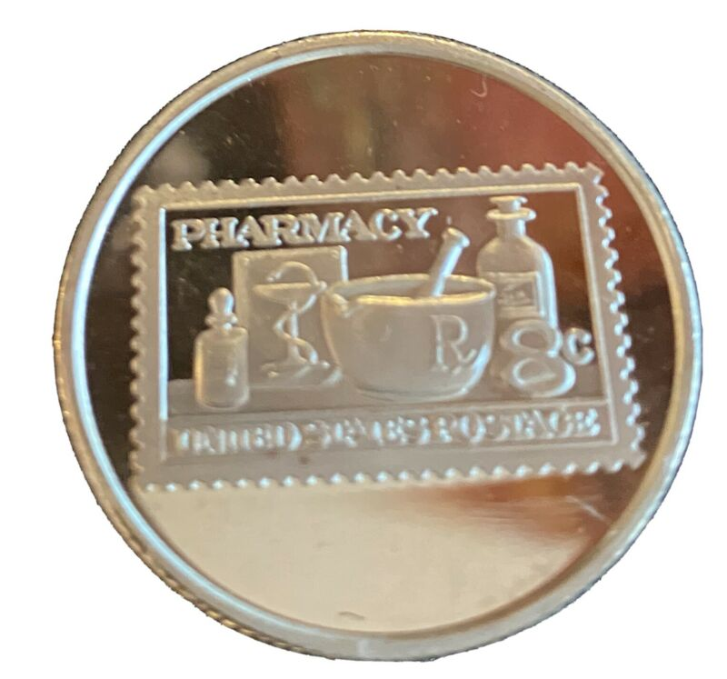 Pharmacy School 1972 U. S. Stamp engraved on a 1 /2 Oz .999 Fine Silver round