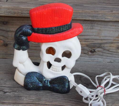 Ceramic Halloween Light Up Skeleton Tipping Hat on Base