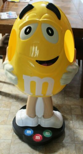 M&M YELLOW CHARACTER CANDY STORE DISPLAY ON WHEELS