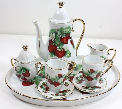 - MINIATURE STRAWBERRIES PORCELAIN TEA SET TEAPOT SUGAR BOWL CREAMER 2 TEACUPS